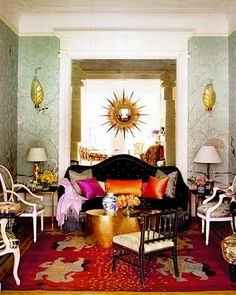 love this living room! Its a little Marie Antionette French, Versace Italian with a Boheme-Indian punch of color. This is truly well put together.