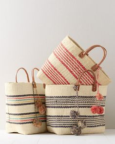 A grab-and-go tote in trendy graphic stripes. Exquisitely handcrafted from sustainable sisal, this structured tote is fully functional, with an abundance of space, and one small interior pocket in sea grass. Removable raffia pom-poms. Leather trim. By Mar Y Sol.