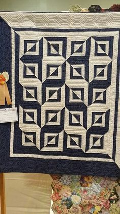 Simple design, fabulously done. With only one block and two colors, you get a lot of impact! Photo taken at Space Coast Quilt Show, Titusville, Florida, 2015.
