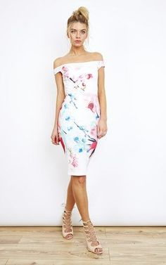 We're in love with this off the shoulder floral midi dress, perfect for those hot summer evenings. The figure hugging bodycon style is guaranteed to turn heads along with the beautiful pink and blue floral print, which ooze elegance. We think this would be perfect for your next summer wedding or a day at the races. Shop Now.