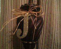 Dress up a lamp with an initial and raffia.
