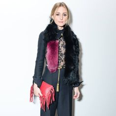 Olivia looks so stylish. I love the wide leg trousers, faux fur scarf and red bag.