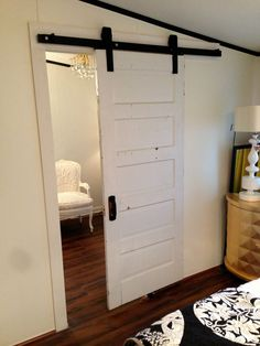 Salvaged door from Southern Accents installed in bedroom as a sliding door - Superior Home Solutions