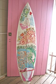 Roxy Surfboard against a pink door. too cute!