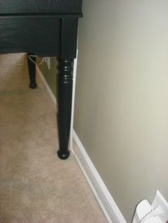 Fantastic way to hide cords. Hiding the cords in out place has been on my to-do list for AGES!