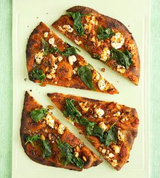 Spinach and Goat Cheese Pizza:    2 whole-grain flatbreads  1/2 cup pizza sauce  2 tablespoons dried oregano  1 cup baby spinach  1/4 cup goat cheese  2 tablespoons pine nuts  Make it: Preheat oven to 350 degrees F. Bake flatbread for 7 minutes. Spread pizza sauce on flatbread and top with oregano, spinach, goat cheese, and pine nuts. Bake an additional 12 to 15 minutes.