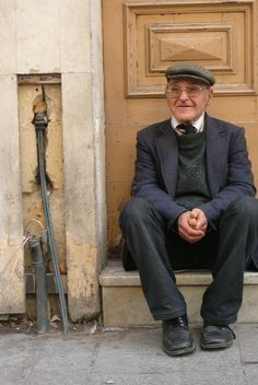 A charming gentleman having a rest on a doorstep