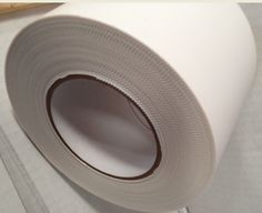 """GPS Heat Shrink Tape was formulated to meet the demanding needs of Shrink Wrapping applications.  This white tape is standard in 4"""" x 180' and 2"""" x 180'.  The 4"""" has pinked edges for easy hand tearing in the field.  This tape adheres very strongly to heat shrink wrap polyethylene.  We made this one to withstand the elements, so it adheres very well over a wide temperature range.  This tape is highly water resistant, is strong and durable, while remaining flexible and conformable."""