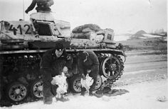Totenkopf tank #412  cleaning chickens during Kharkov 1943.