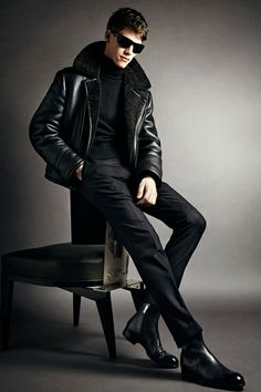 Tom Ford Fall-Winter 2014 Men's Collection Very Sleek look, leather and fur in seen across many high named brands. Classic black leather jacket with black fur collar, matching patent leather shoes
