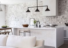 〚 Stone wall in the kitchen and other Mediterranean touches: beautiful renovation of small California home 〛 ◾ Фото ◾Идеи◾ Дизайн Kitchen Lamps, Kitchen Decor, Kitchen Interior, Kitchen Ideas, Home Design, Interior Design, Rose Bowl Flea Market, Eldorado Stone, Light Wood Kitchens