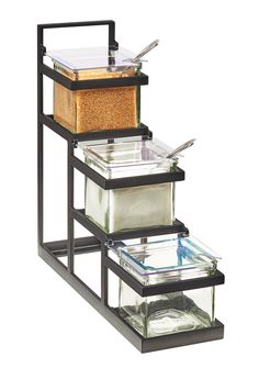 Item: 3605-13   Stair-Step 4x4 Jar Display Keep it simple! The Stair-Step 4x4 Jar Display keeps jars in-line and in order. The handle on top allows for easy lifting and transport, while the glass jars sit perfectly in their seperate tiers.