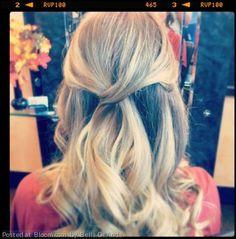 Beautiful loose curls and pinned back look by Bella DeAnda.
