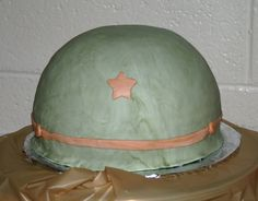 Cake was half of ball pan, with fondant icing. Design inspired by other fabulous helmets here on CC.