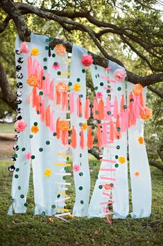 This colorful backdrop is handmade and can be purchased for your wedding, party or shower!