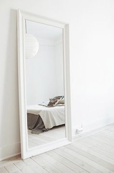 I love giant mirrors {or art} that are leaned against the wall instead of being hung. Gives a room a different feel.