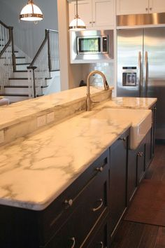 Vermont Danby Marble Kitchen With Farm House Sink By Stone Saver Inc.