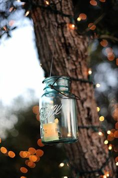 Use tea lights inside bell jars for pretty outdoor wedding lights | by Hazelnut Photography