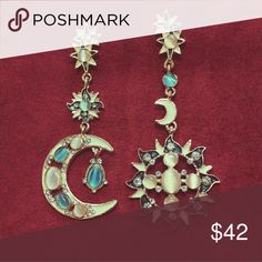 Asymmetric celestial earrings Striking pair of earrings with stud placement and moon and sun pendants that hang down. Adorned with peach and aqua stones and tiny crystals, complemented by teal metallic and cream enamel. Definitely eye-catching and unique Jewelry Earrings