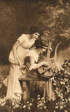 Ladies with lyre guitar...