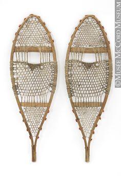 Snowshoes,  Eastern Subartic.  Atikamekw.  1900-1930.  Wood, babiche, fibre, metal.  20.7 x 65.5 cm.  Gift of Mrs. Marguerite Rounds.  ME977.154.9.1-2 © McCord Museum.