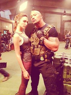 Gal Gadot and Dwayne Johnson as Giselle and Hobbs. Fast and Furious franchise.