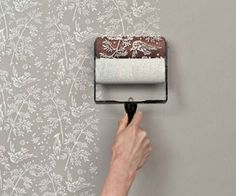 pattern paint roller. I'm sure it's not quite as easy as they make it out to be. But still cool