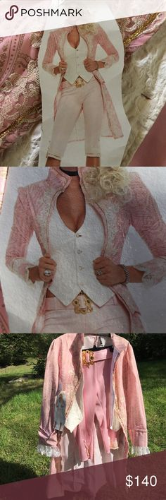 NWT. Sexy and classy Marie Antoinette costume. Capri pant have zipper and belt with gold buckle. Also has 3 gold and white buttons. Pants are a shiny fabric. Long soft velvety jacket has built in textured vest. Pretty lace on bottom of sleeves. Lace and gold embellishes entire costume. Vest and capris have matching buttons. Very long slit in the back of jacket. Stunning!!!!!! Leg Avenue Other