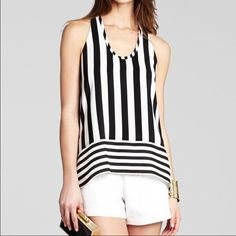 """BCBG """"Dana"""" Top New with tags! Black and white silk top with open back and halter neck. A little shorter in the front than the back. Perfect for your spring wardrobe! BCBG Tops Tank Tops"""