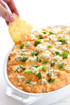 Slow Cooker Buffalo Chicken Dip -- the irresistible appetizer we all love, made extra easy in the crock pot! | gimmesomeoven.com