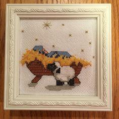 Tiny nativity cross stitch.