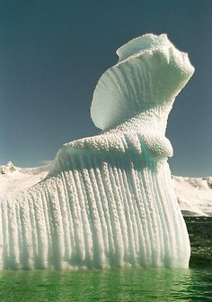 Actually, it's an ice sculpture of a stunning woman looking up and to the right, with fantastic hair.  Do you see?      :        Spiral iceberg in Antarctica