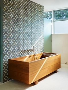 Current tile trends are all about something unexpected, be it the design, color or patina of the individual tile or the pattern in which the tile is laid. Abramson Teiger Architects has us drooling over this tile feature wall. The tile blends an understated geometric pattern with a patina that is reminiscent of antique Moroccan tile. The result is an earthy yet sophisticated look at home in any spa bathroom.