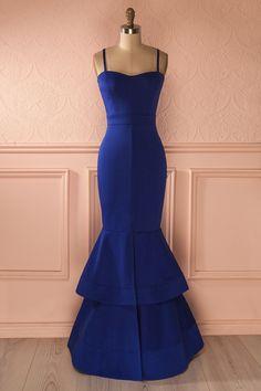 Telle une nymphe de rivière, son entrée fit bien des remous dans la salle. She entered the room in a swirl, like a nymph of the river. Nareen - Blue ruffled hem party gown www.1861.ca