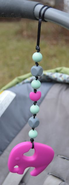 Baby Silicone Teething Toy: Car Seat Chain Silicone by KiaraAndMe