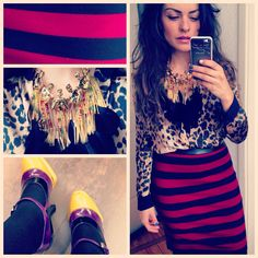 Red striped skirt and animal print blouse accessorised with mermaid and feather necklaces and prada heels.  Streetstyle.