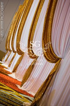 Suhaag Garden, Hyatt Regency Orlando, wedding reception decor, gold sequins, centerpieces, manzanita branches, draped curtain, Florida Indian wedding decorator, event designer, destination wedding in Florida