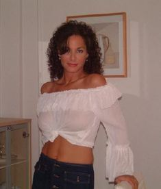 Hot mature mom wearing no bra and white top smiles