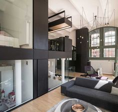 Neulant van Exel Creates The Living Cube Inside an Apartment in Berlin Berlin Apartment, Black Cabinets, House Elevation, Coworking Space, Minimalist Kitchen, Small Apartments, White Walls, Second Floor, Cube