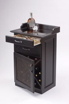 """Executive Wine, Cigar   Heirloom quality combination wine, cigar & liquor cabinet. """"Espresso"""" finish on solid hardwood. Bronzed glass top insert shows top drawer cigar tray. Antique Bronze mesh door panel with matching drawer hardware. Spanish Cedar cigar tray in full extension drawer. Bottom drawer suitable for 'Cigar Oasis"""" humidifier. 16-20 bottle capacity."""