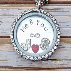 A beautiful, personalized couples floating locket necklace with hand stamped initial plate. The perfect wedding or anniversary gift! #weddinggift #anniversarygift #wifegift #wifeanniversary #anniversary #lovelocket #love #infinity #couplesnecklace #couplesjewelry #handstampednecklace #handstampedjewelry