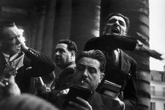"Paris. 1936. Spring. ""Curb"" traders outside the stock exchange//Robert Capa"