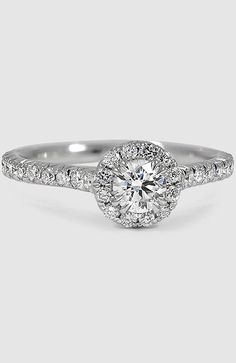 Elegant French pavé set diamonds form a stunning halo for a truly glamorous effect.