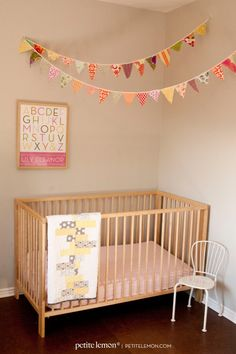 Love this for baby nursery! Check out our fabric pennant tutorial ... darling in any nursery or kid's room