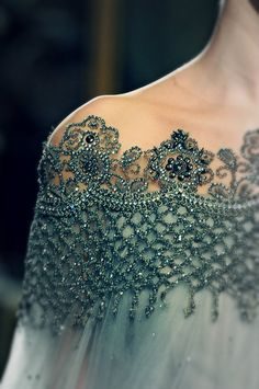 This reminds me of the detailing on one of Barbra Streisand's costumes in Funny Girl.