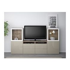 """IKEA - BESTÅ, TV storage combination/glass doors, black-brown/Marviken white clear glass, drawer runner, soft-closing, 94 1/2x15 3/4x50 3/8 """", , The drawers and doors close silently and softly, thanks to the integrated soft-closing function.The space-saving wall cabinets make the most of the wall area above your TV.It's easy to keep the cords from your TV and other devices out of sight but close at hand, as there are several cord outlets at the back of the TV bench.The cable outlet at the…"""