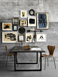 Love the use of art clutter to 'frame' this super cool dining room space in an open plan living layout.