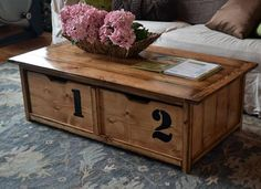 Coffee table with toybox trundle.  Toys are hidden in plain sight.