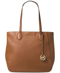 "Michael Michael Kors' zip tote pairs rich, supple leather with minimalist gleams of shiny hardware to give you quintessential sleek everyday style. | Leather; lining: polyester | Imported | 15-1/2""W x"