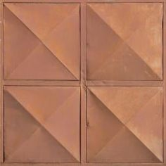Metal texture in brown tone with diamond patterns on surface.